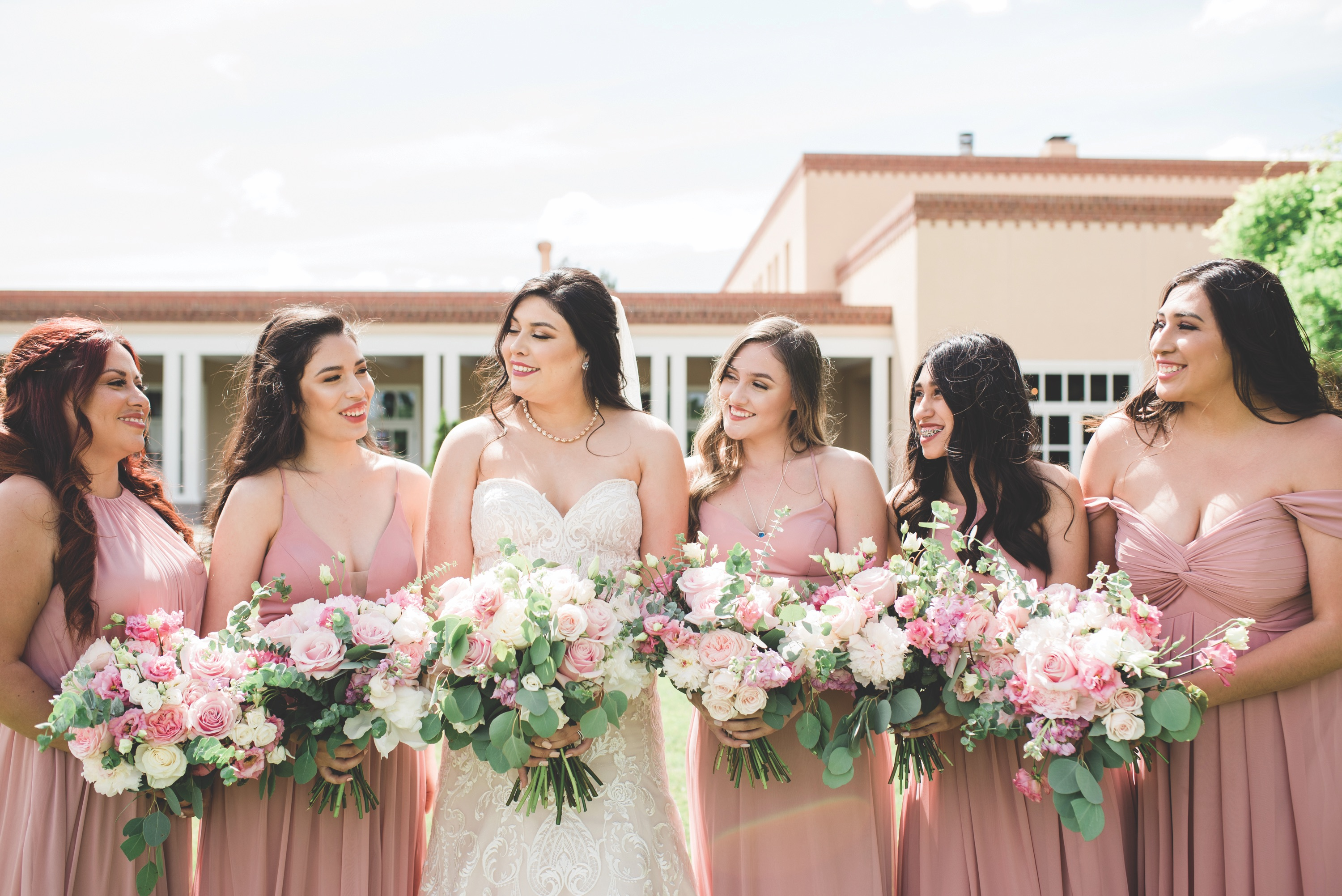 bride smiling at her bridesmaids, bride, new mexico bride, hotel albuquerque at old town, abq flowers, new mexico weddings, perfect wedding guide