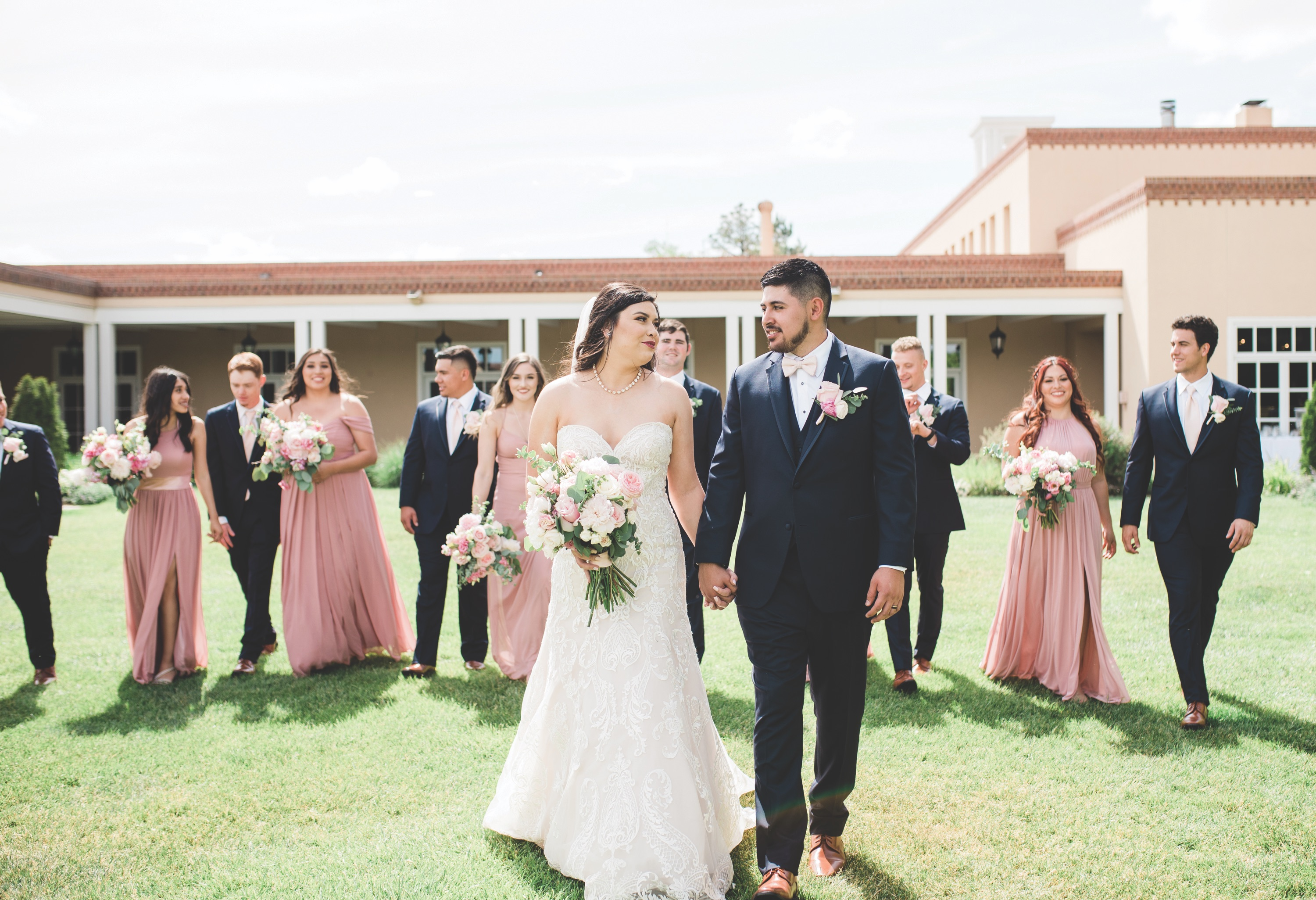 bride and groom outside with their bridesmaids and groomsmen, bride smiling, bride, new mexico bride, hotel albuquerque at old town, abq flowers, new mexico weddings, perfect wedding guide