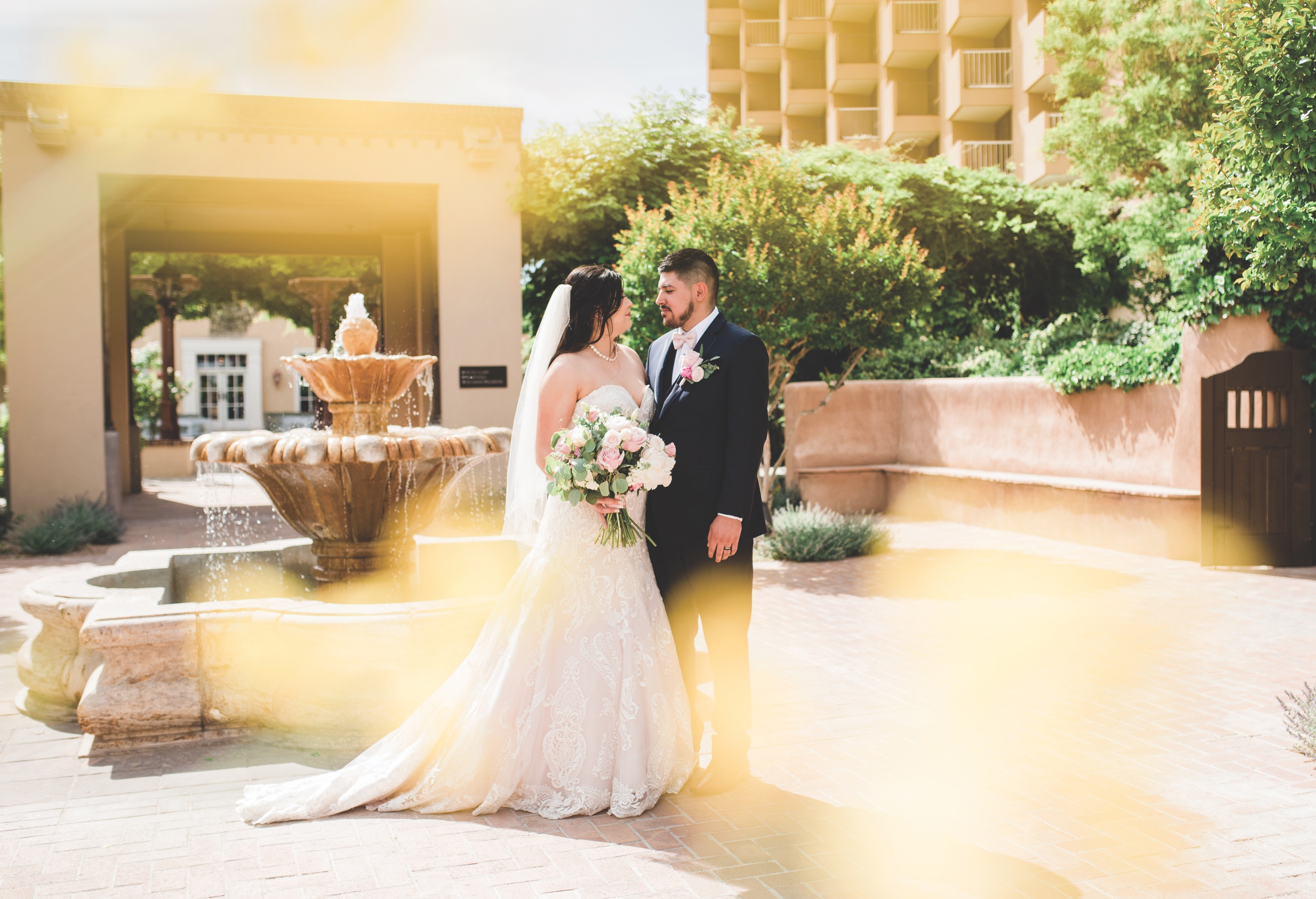 bride smiling at groom, bride, new mexico bride, hotel albuquerque at old town, abq flowers, new mexico weddings, perfect wedding guide